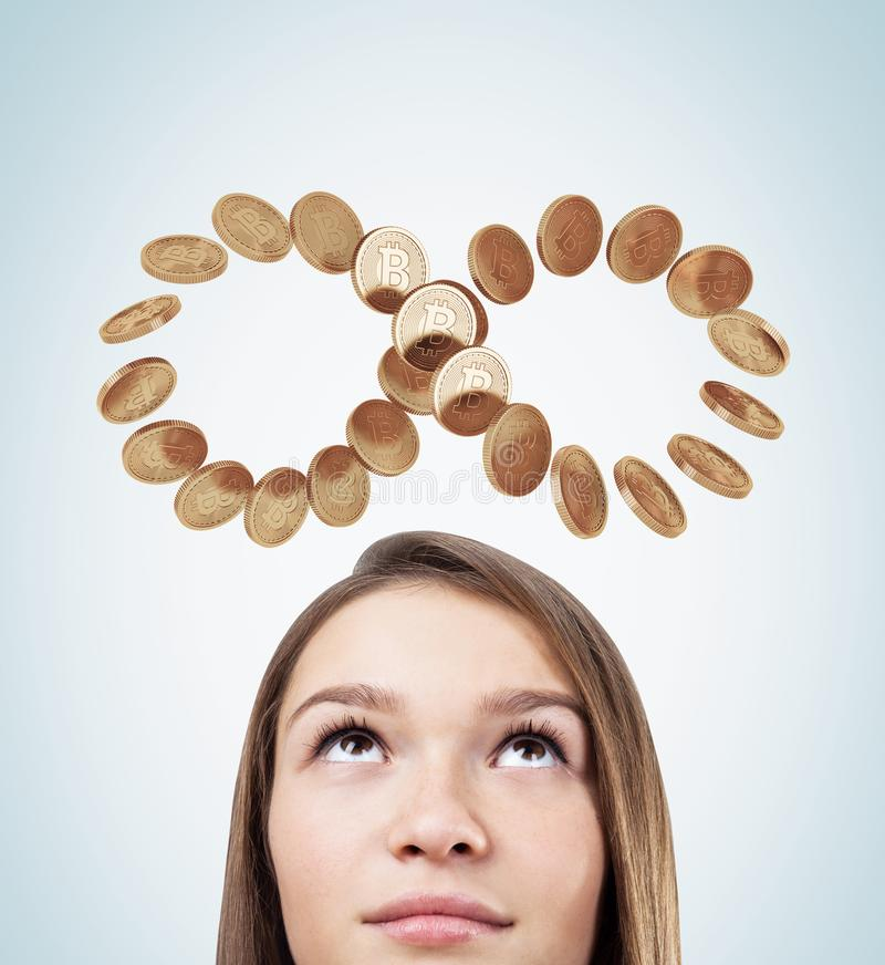 Bitcoins da jovem mulher, um laço da infinidade ilustração stock