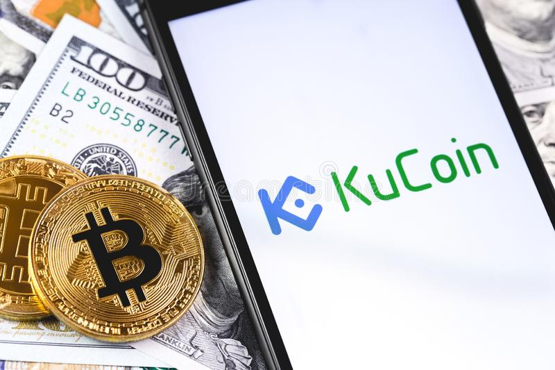Bitcoins, dollars with KuCoin logo on the screen smartphone stock images