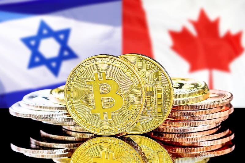 Bitcoins en fondo de la bandera de Israel y de Canadá imágenes de archivo libres de regalías