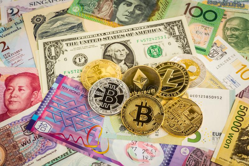 Cryptocurrency coins, electronic money on worldwide banknotes ca stock photos
