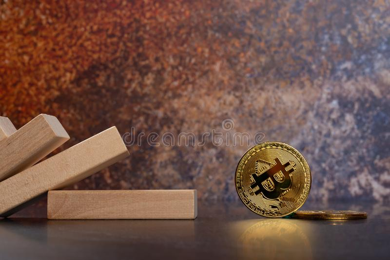 Bitcoins fell down from domino blocks. Horizontal composition stock images