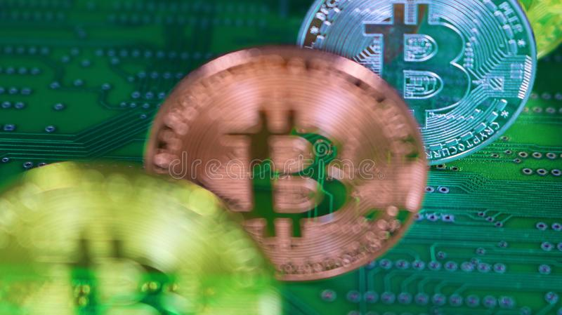 4 Bitcoins with focus on 3rd coin back stock photos