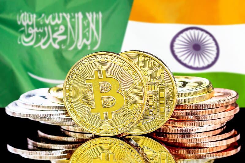 Bitcoins fundo na bandeira de Arábia Saudita e de Índia foto de stock