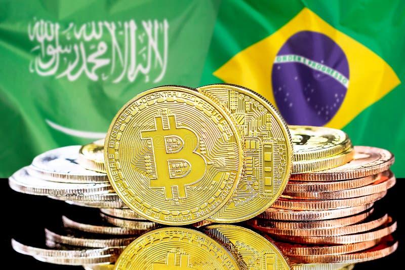 Bitcoins fundo na bandeira de Arábia Saudita e de Brasil imagem de stock royalty free