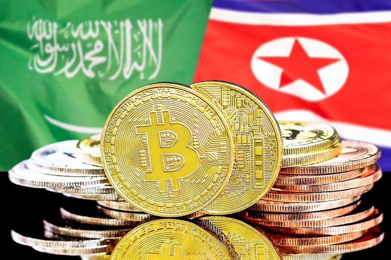 Bitcoins fundo na bandeira de Arábia Saudita e de Coreia do Norte fotos de stock royalty free