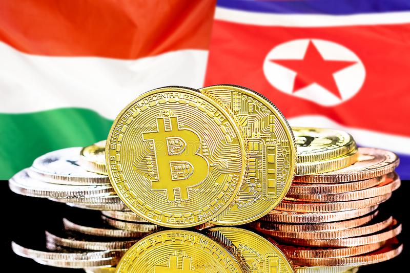 Bitcoins on Hungary and North Korea flag background stock photos