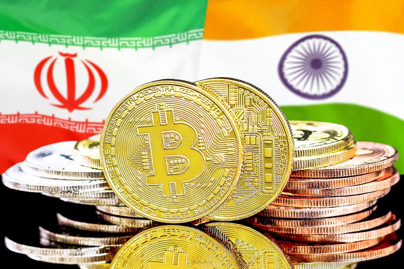 Bitcoins on Iran and India flag background. Concept for investors in cryptocurrency and Blockchain technology in the Iran and India. Bitcoins on the background royalty free stock image