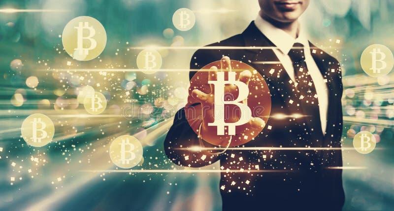 Bitcoins mit Geschäftsmann stock abbildung