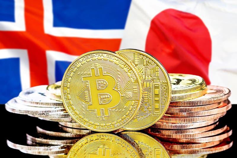Bitcoins på Island och Japan flaggabakgrund royaltyfri bild