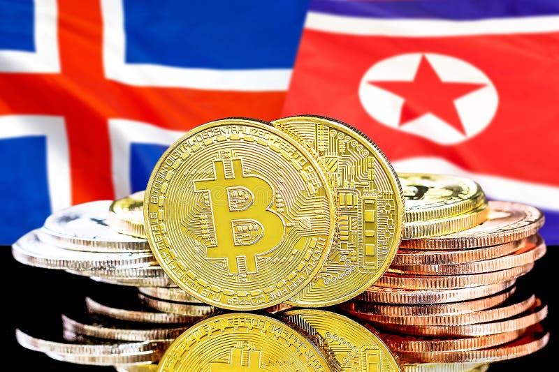 Bitcoins på Island och Nordkorea flaggabakgrund royaltyfri foto