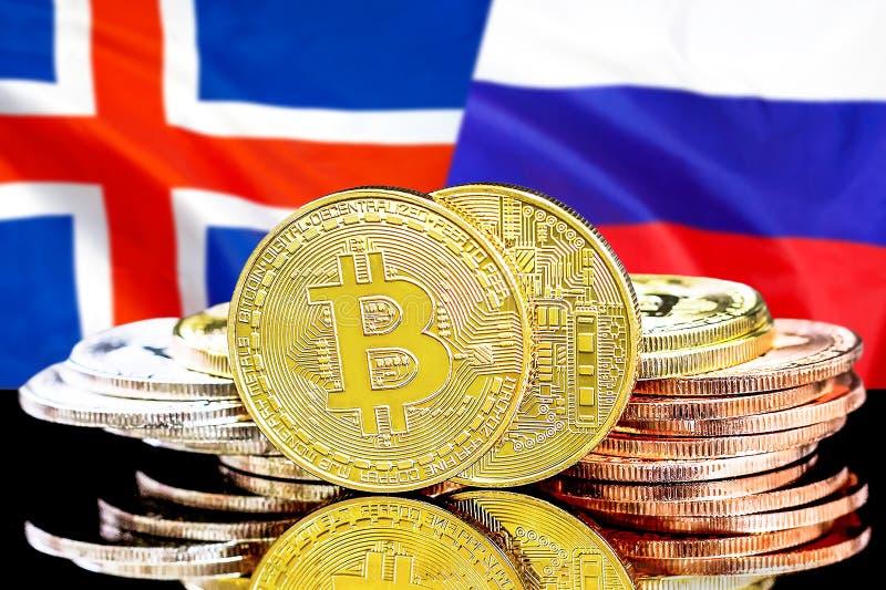 Bitcoins på Island och Ryssland flaggabakgrund arkivbilder