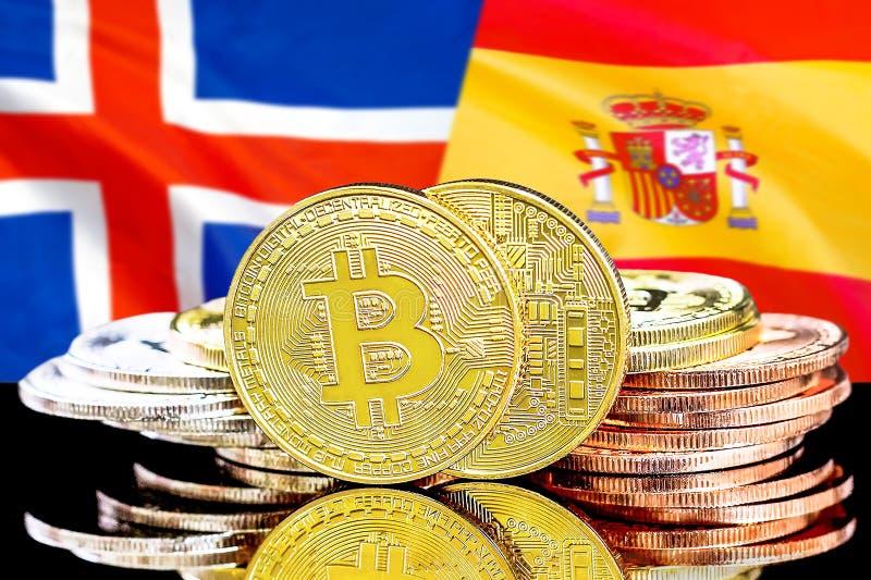 Bitcoins på Island och Spanien flaggabakgrund arkivfoton