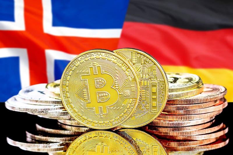 Bitcoins på Island och Tysklandflaggabakgrund royaltyfri fotografi