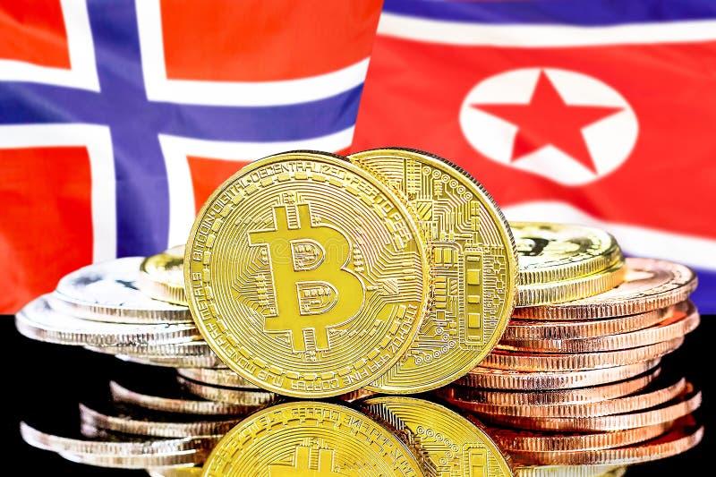 Bitcoins på Norge och Nordkorea flaggabakgrund arkivbilder