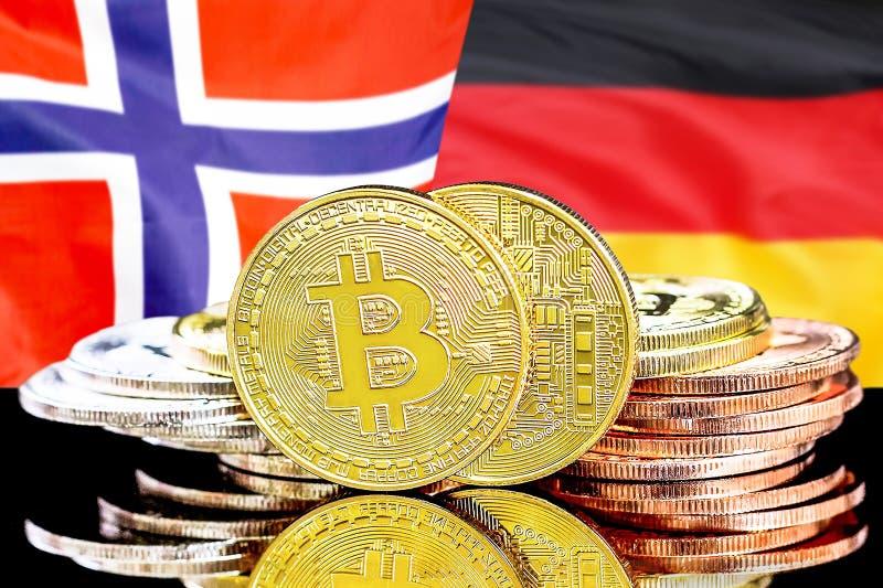Bitcoins på Norge och Tysklandflaggabakgrund royaltyfri foto