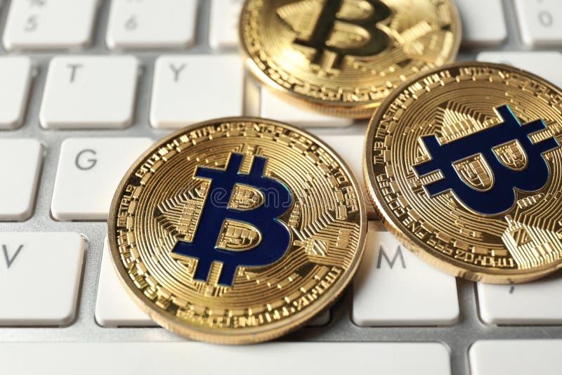 Bitcoins on PC keyboard, closeup royalty free stock image