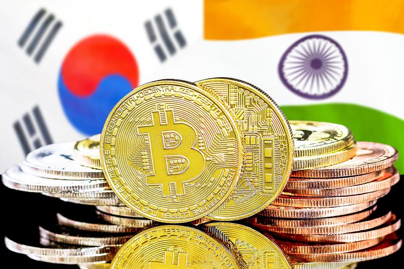 Bitcoins on South Korea and India flag background. Concept for investors in cryptocurrency and Blockchain technology in the South Korea and India. Bitcoins on royalty free stock image