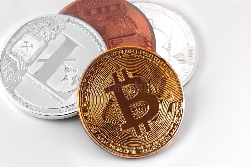 Bitcoins y Litecoin imagenes de archivo