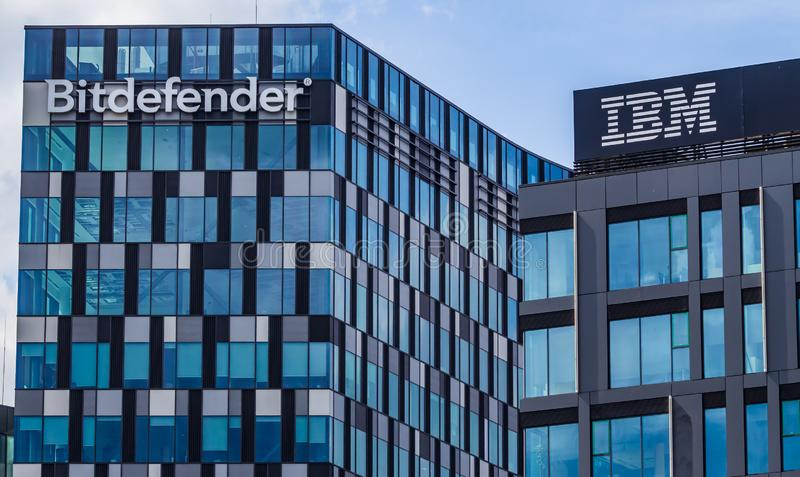 Bitdefender headquarters and IBM building, in Bucharest, Romania. Bucharest, Romania - September 11, 2019: The logo of Romanian cybersecurity and anti-virus royalty free stock photos