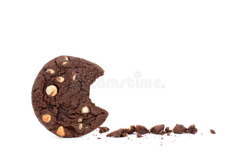 Bite of cookie and crumbs. Dark chocolate chip cookie with a bite and crumbs white background stock photos