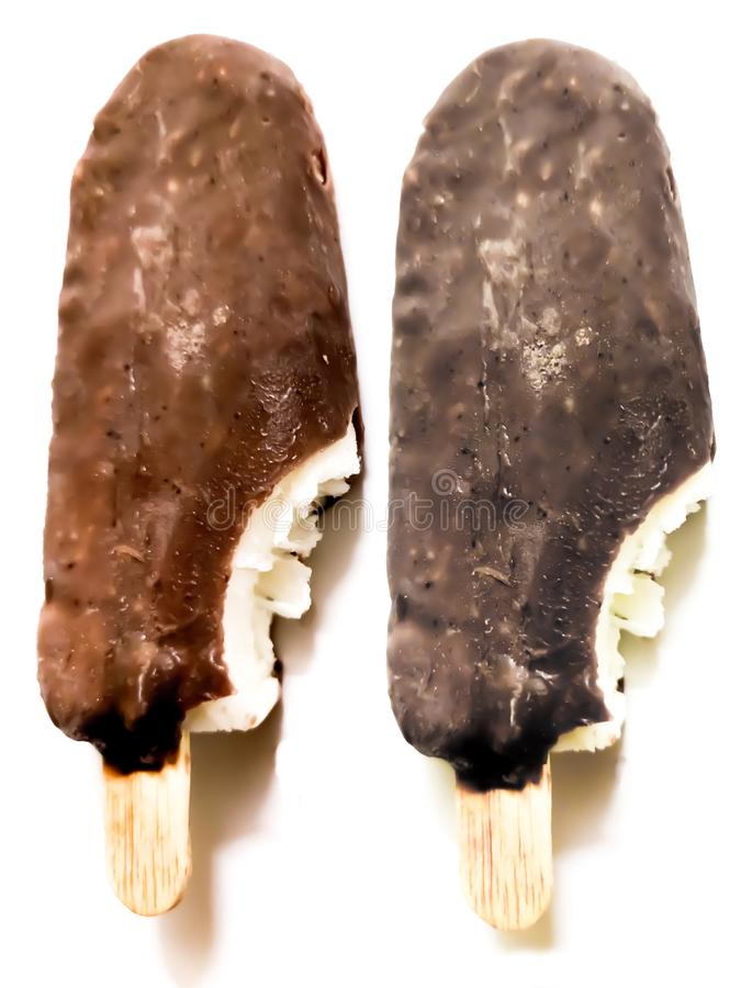 Bite ice cream covered by brown chocolate  on white background. Ice-cream, icecream, popsicle, closeup, food, lolly, stick, dessert, detail, sundae, fresh stock photography