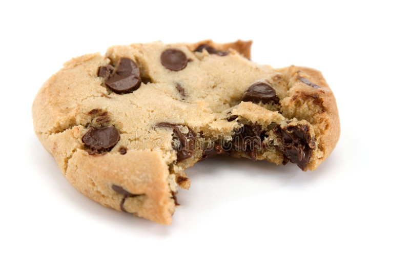 Bite out of Chocolate Chip Cookie. Single chocolate chip cookie with a single bite stock photo