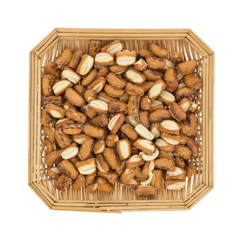 Bite size sourdough pretzels in a wicker basket stock photo