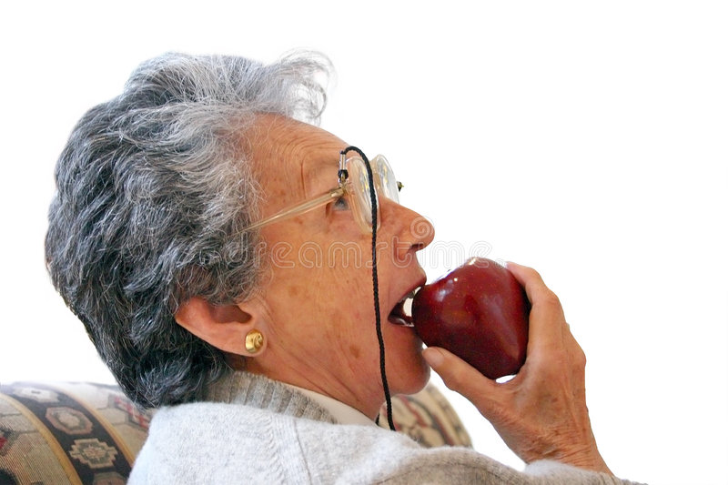 Download Biting an apple stock image. Image of blue, grandmother - 110881