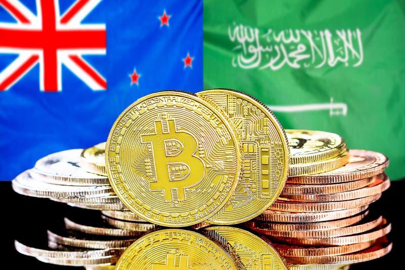 Bitmunten op de achtergrond van Nieuw-Zeeland en Saudi-Arabië stock afbeeldingen