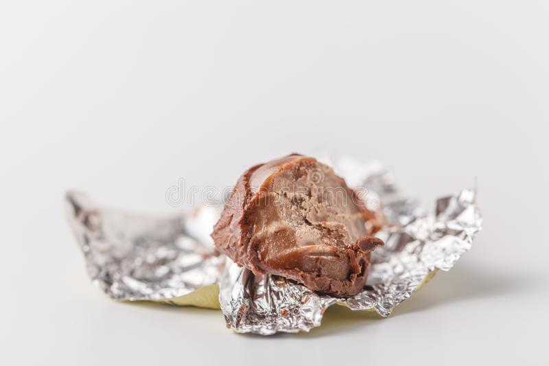 Bitten chocolate candy in a candy wrapper stock image