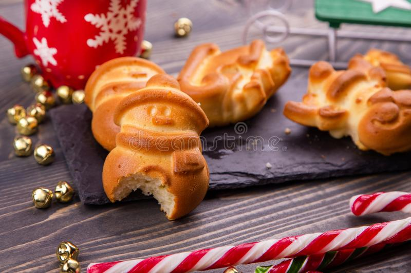 Bitten Christmas gingerbread in form of a snowman. Children`s pranks. New Year royalty free stock image