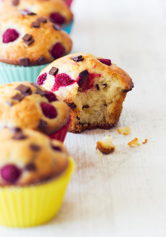Bitten muffin out from the line stock images
