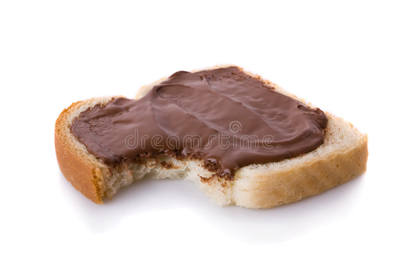 Bitten slice of bread covered with Hazelnut stock photo