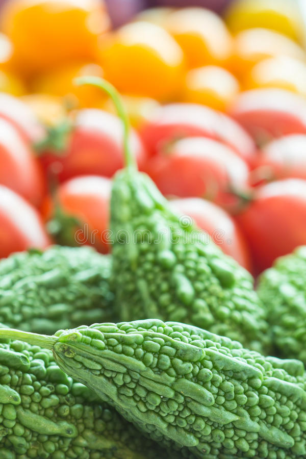 Bitter gourd. And tomatoes colorful appetizing royalty free stock photography