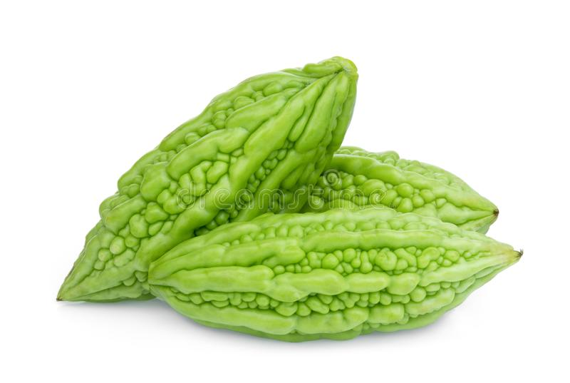 Bitter melon, balsam pear, bitter cucumber or bitter gourd isolated on white. Background stock photos
