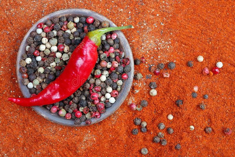 Red ground pepper and a mixture of peppers. close up. Bitter pepper. bitter pepper and a mixture of peppers royalty free stock photography