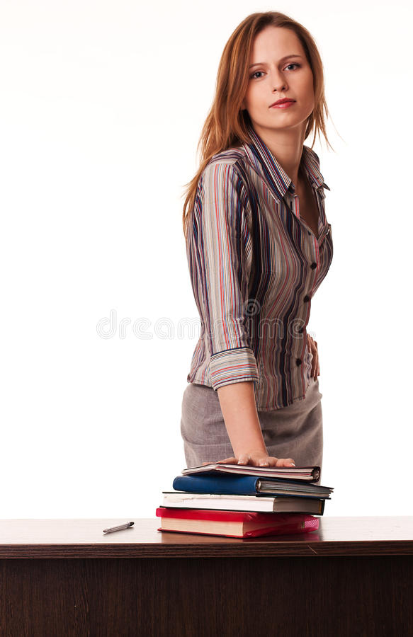 biurka przystojni trwanie nauczyciela potomstwa zdjęcie stock