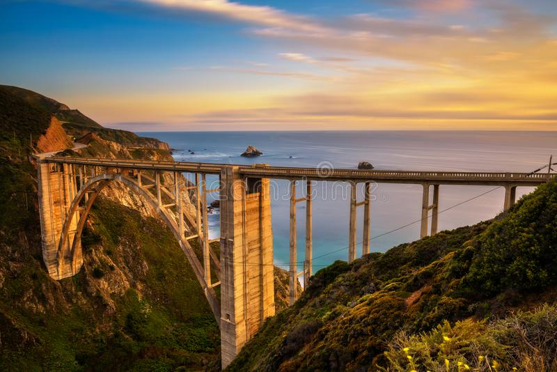Bixby Bridge and Pacific Coast Highway at sunset. Near Big Sur in California, USA. Long exposure royalty free stock photo