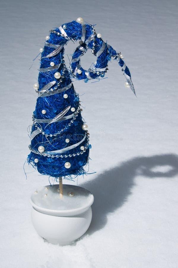 Bizarre chrismas tree. Bizarre blue chrismas tree standing in the snow stock image