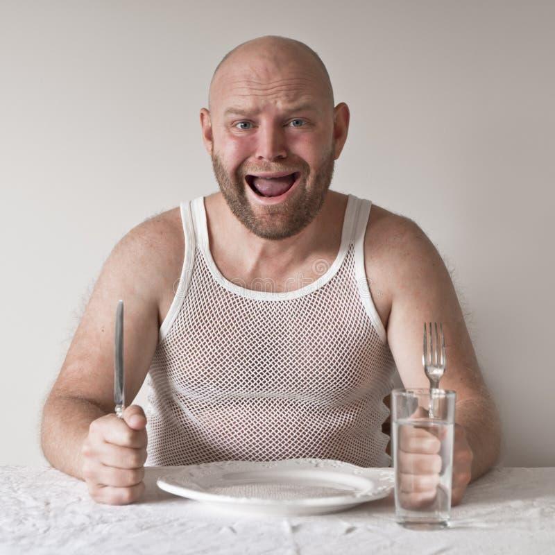 Bizarre en Hongerige Mens stock afbeelding