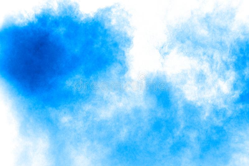 Bizarre forms of blue powder explode cloud on white background. Launched blue dust particles splashing stock image