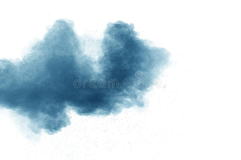 Bizarre forms of blue powder explode cloud on white background. Launched blue dust particles splashing royalty free stock photo