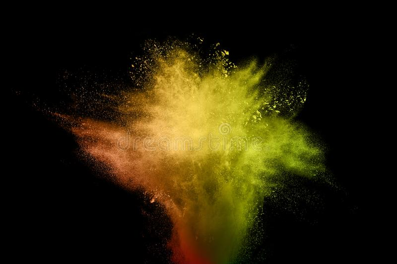 Abstract color powder explosion on black background.abstract Freeze motion of color dust particles splash. Bizarre forms of powder painted and flour combined royalty free stock image
