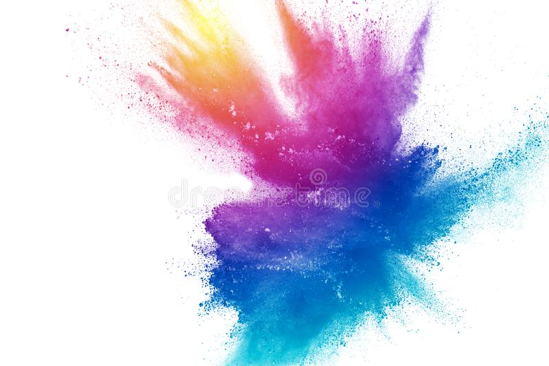 Bizarre forms of powder painted and flour combined explode in front of a white background stock photo