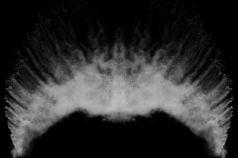 Bizarre forms of white powder explosion cloud against black background.White dust particles splash.  royalty free stock photography