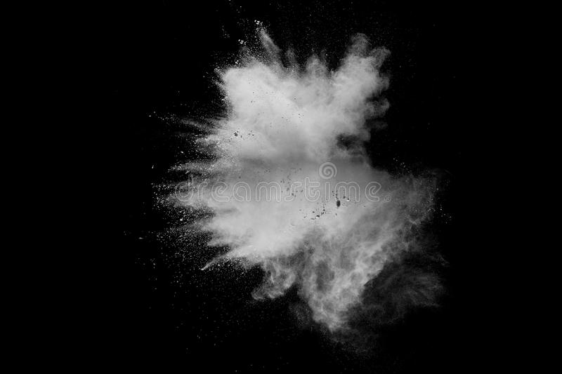 Bizarre forms of of white powder explosion cloud against dark background. Launched white dust splash on black background royalty free stock photos