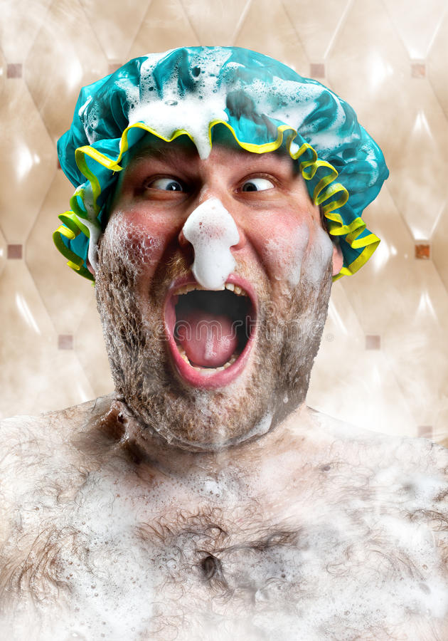 Bizarre man with soap foam on nose. Taking bath stock photos