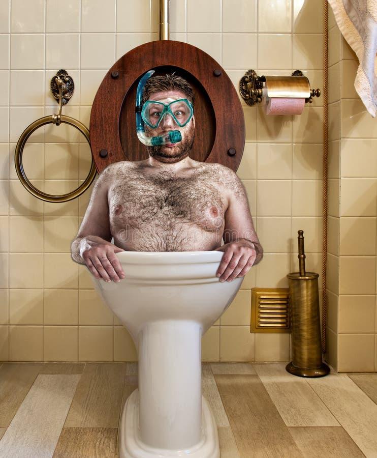 Bizarre man in vintage toilet royalty free stock photos