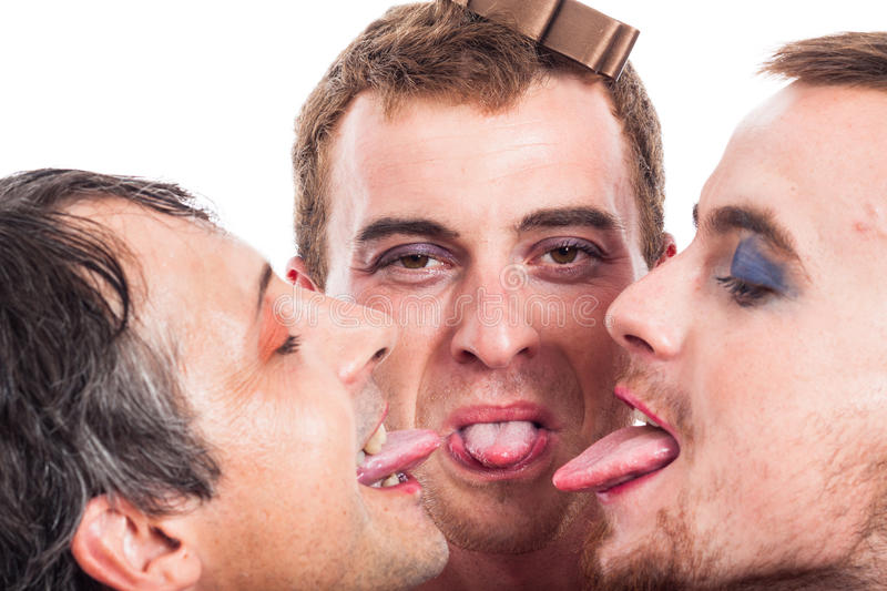 Bizarre men sticking out tongue stock photography