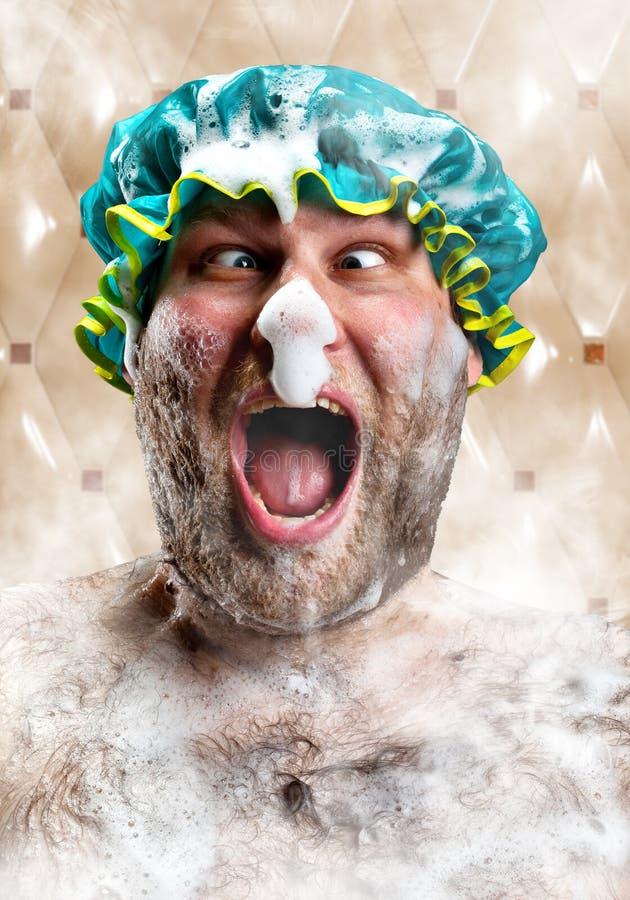 Bizarre mens met zeepschuim op neus stock foto's